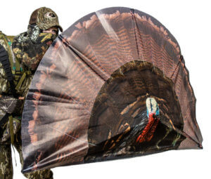 This turkey hunting gift idea photo shows a hunter behind the Primos Double Bull SurroundView Turkey Decoy product.