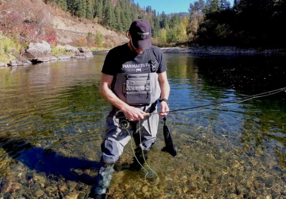 This review photo shows a fly fisherman wearing the new Orvis PRO wader while fishing in a river.