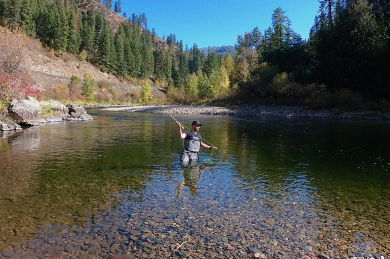 This photo shows a fly fisherman wading in a river while wearing the Orvis PRO Wader.
