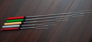 This camping gift photo shows the Rolla Roaster campfire roasting forks.