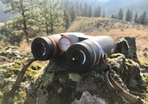 This photo shows the Maven B.1 Binoculars outside on a rock.