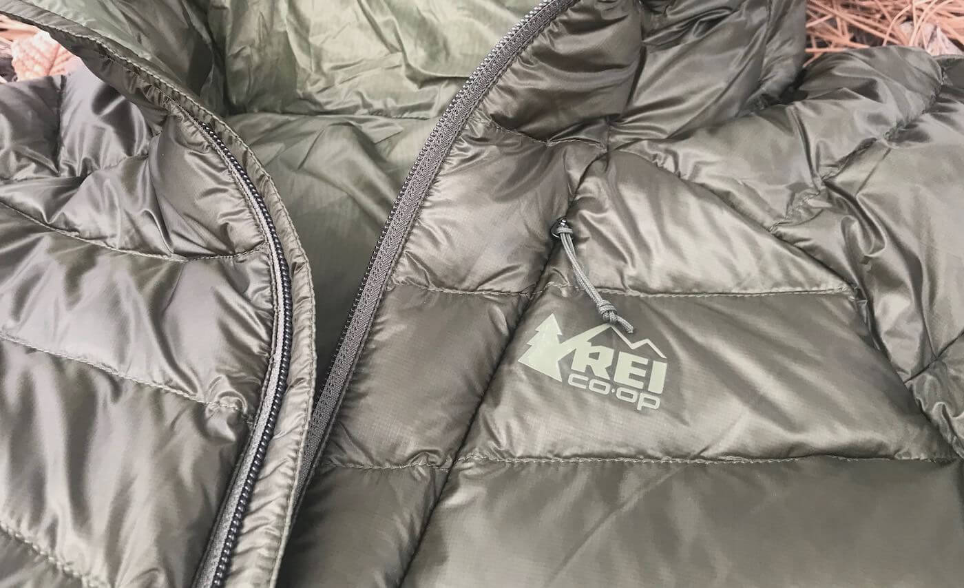 This photo shows the REI Co-op Magma 850 Down Hoodie 2.0 men's down jacket in a closeup.