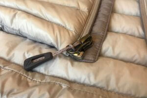 This photo shows the zipper on the REI Co-op Women's Magma 850 Down Hoodie 2.0.