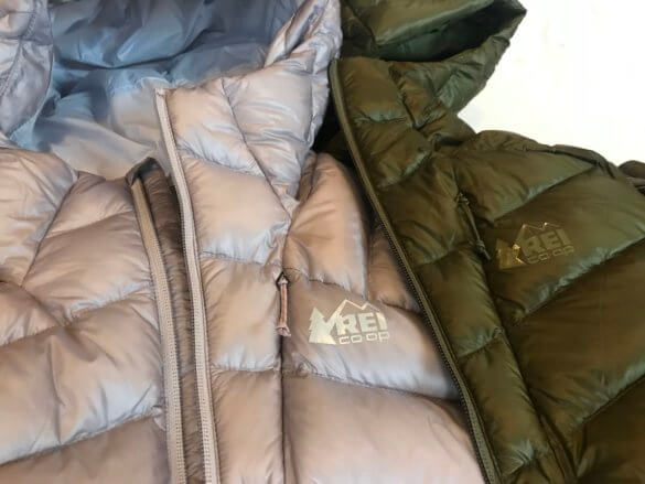 This photo shows both the women's and the men's version of the REI Co-op Magma 850 Down Hoodie 2.0 down jacket in a closeup.