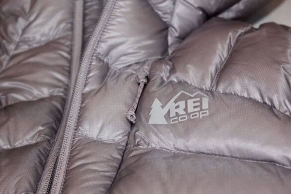 This photo shows the REI Co-op Magma 850 Down Hoodie 2.0 women's version in a closeup.