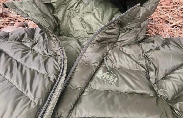 This photo shows the REI Co-op Magma 850 Down Hoodie 2.0 in a closeup of the men's army cot green color option.