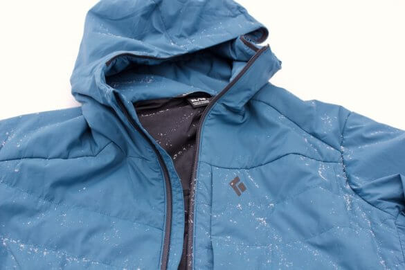 This photo shows the Black Diamond First Light Stretch Hoody men's lightweight insulated jacket.