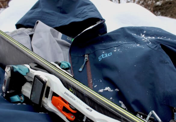 This photo shows the Stio Environ Jacket with skis.
