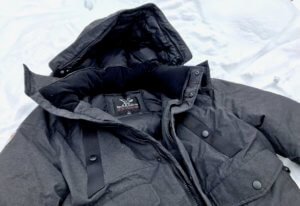 This photo shows the Triple F.A.T. Goose Norden Hooded Bomber Jacket with the fur trim removed from the hood.