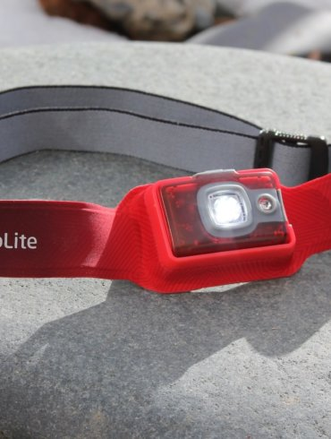 This photo shows the BioLite HeadLamp 200 headlamp with the light on.