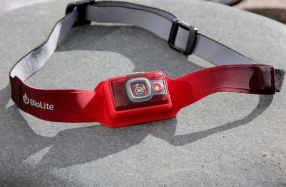 This photo shows the BioLite HeadLamp 200 headlamp with the red light option on.