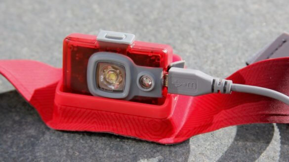 This photo shows the BioLite HeadLamp 200 headlamp with the USB charging cable.