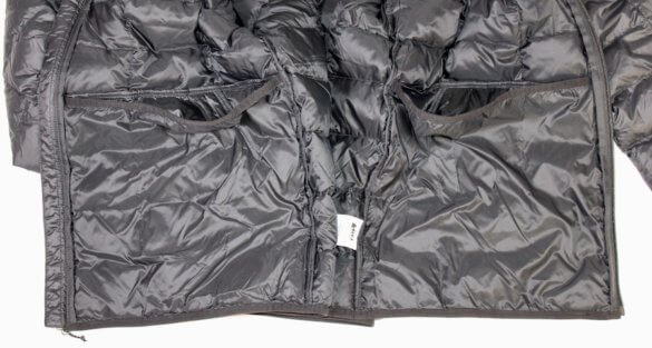 This photo shows the two interior stash pockets on the REI Co-op 650 Down Jacket 2.0.