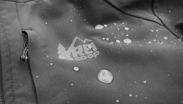 This review photo shows the REI Co-op Activator Soft-Shell Jacket DWR finish with water droplets.