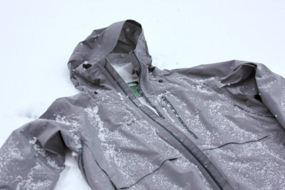 This photo shows the Stio Raymer hardshell ski jacket outside in snow.