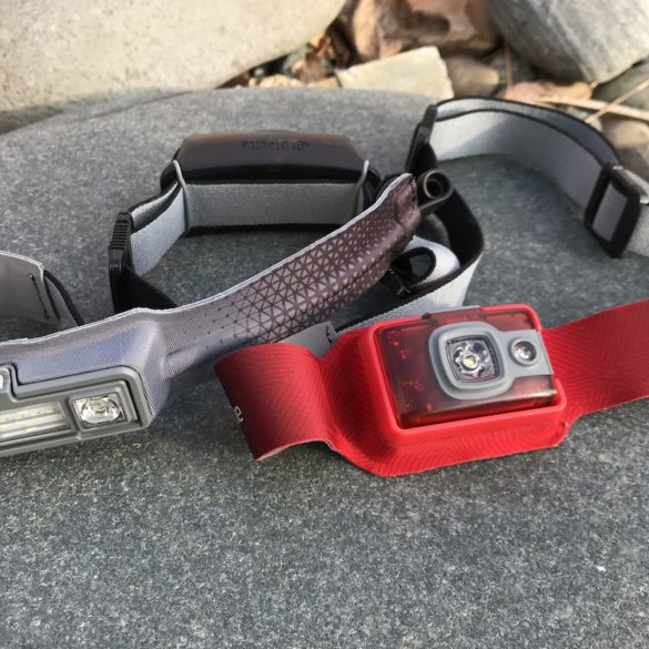 This photo shows the BioLite HeadLamp 200 next to the HeadLamp 330.