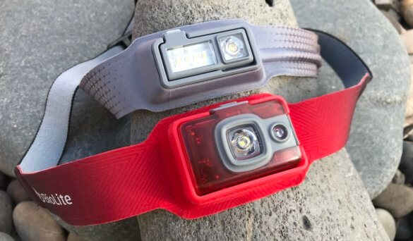This photo shows the BioLite HeadLamp 200 next to the HeadLamp 330 front lights.