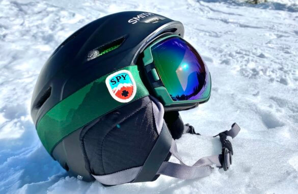 This photo shows the SPY Legacy snow goggles on a skiing helmet.