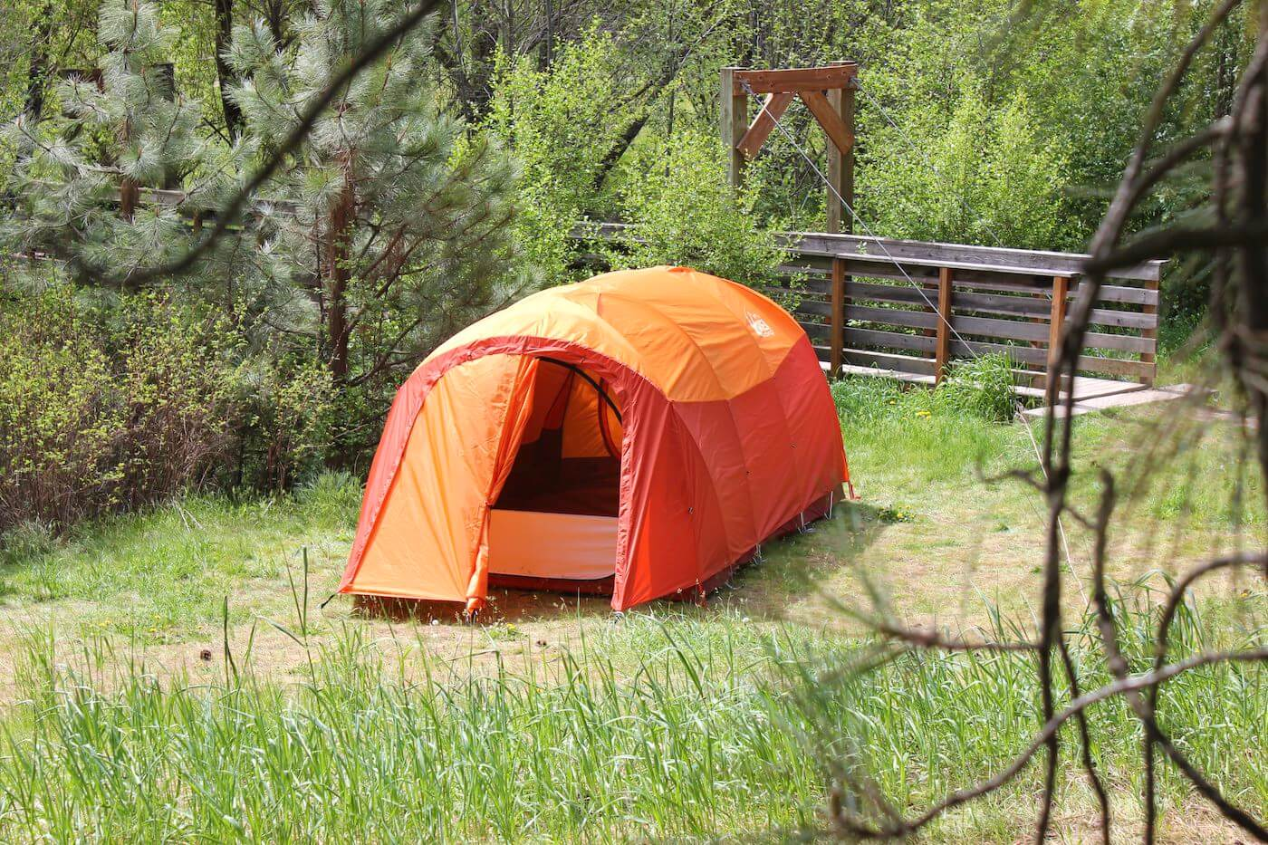 This best camping tents photo shows a camping tent set up at a campsite outside.