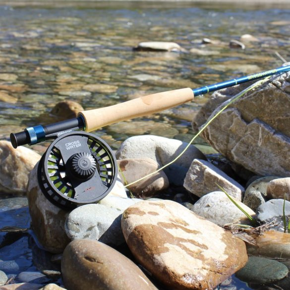 This review photo shows the Redington Crosswater Combo near a river.
