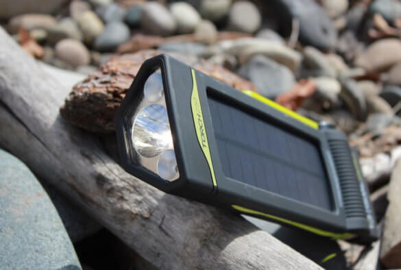 This review photo shows the Goal Zero Torch 250 solar flashlight and phone charger outside.