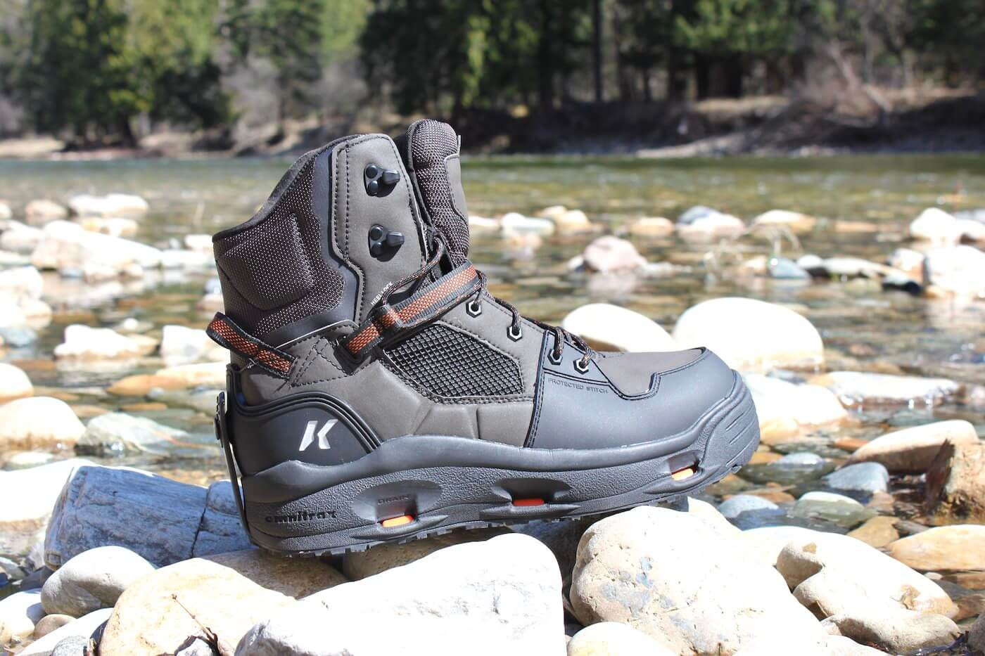This review photo shows the Korkers Terror Ridge wading boots on rocks near a river.