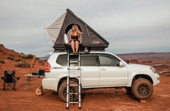 This photo shows the Roofnest Falcon rooftop tent on top of a Toyota SUV.