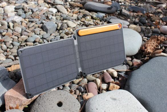 The review photo shows the BioLite SolarPanel 10+ solar panel charging in the sun.