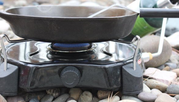 This photo shows the blue propane flame on a Coleman PowerPack Propane Camping Stove.