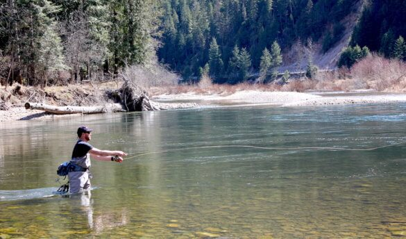 This photo shows a fly fisherman fishing with the new Orvis Recon Fly Rod.