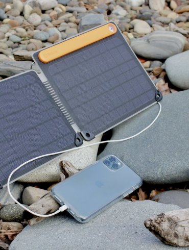 This review photo shows the BioLite SolarPanel 10+ charging a smartphone in the sun.