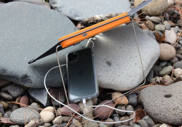 This photo shows the BioLite SolarPanel 10+ charing an iPhone.