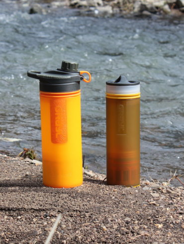This photo shows the GRAYL GEOPRESS Purifier and GRAYL ULTRALIGHT Purifier next to a creek.