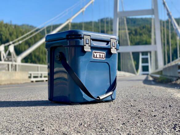 This review photo shows a closeup of the YETI Roadie 24 cooler on the edge of a road.