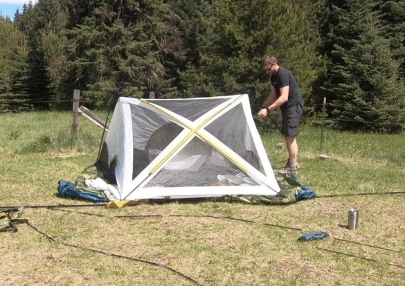 This review photo shows the author setting up the Acadia 6-Person Family Camping Tent.