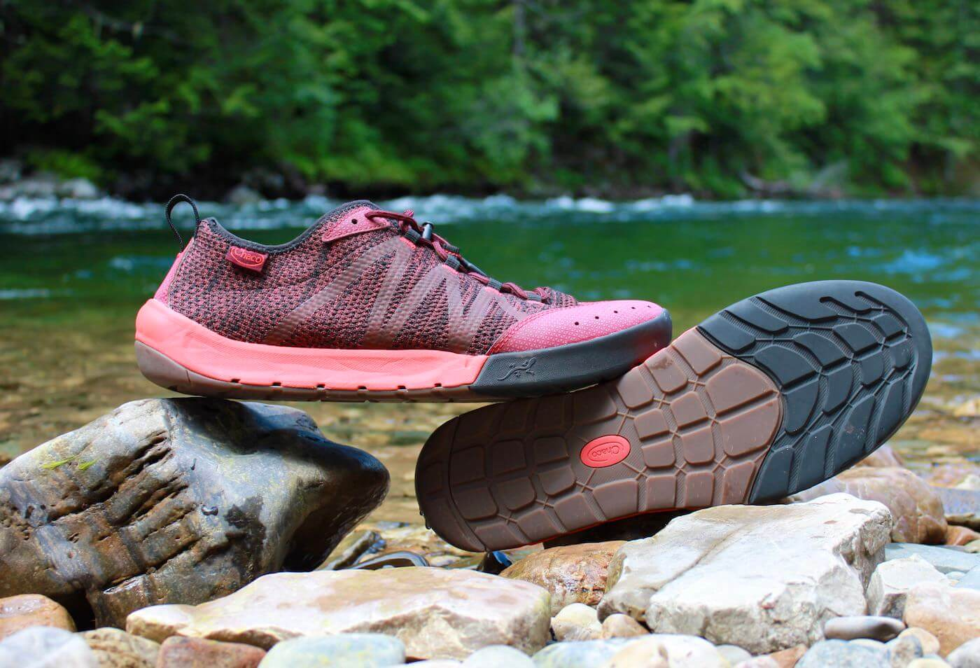 This review photo shows the Chaco Torrent Pro Water shoes next to a river.