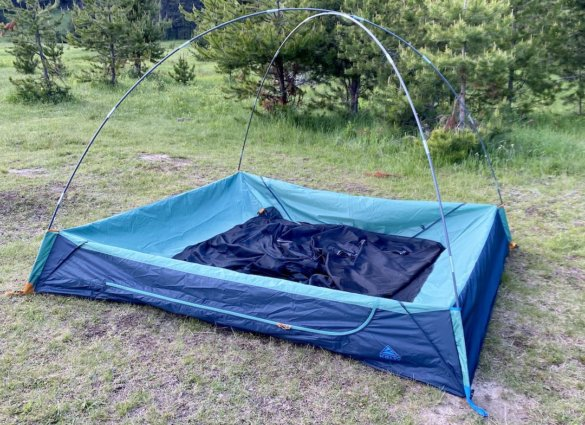 This test and review photo shows the Kelty Wireless 4 Tent partially setup.
