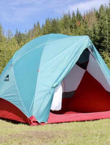 This testing and review photo shows the MSR Habitude 4 Tent sent up at a camping site.