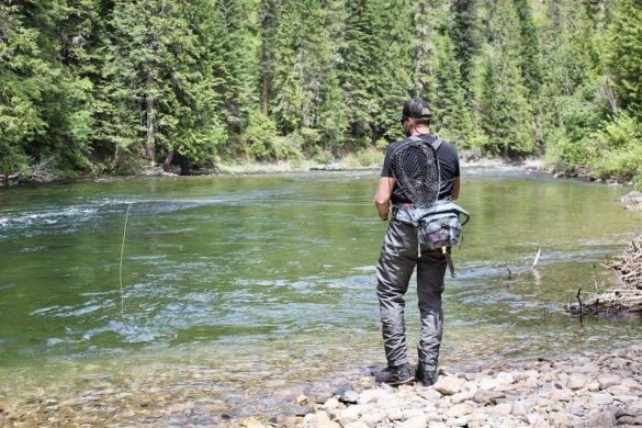 This photo shows the author wearing the Patagonia Swiftcurrent Expedition Zip-Front Waders near a river.