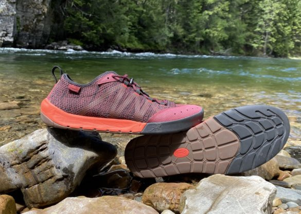 This gear testing and review photo shows the men's Chaco Torrent Pro water shoes next to a river in Idaho.