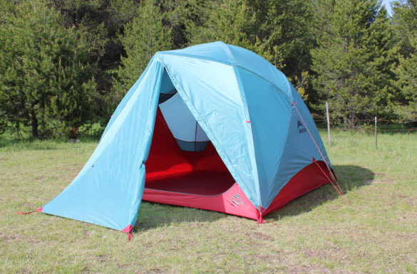 This photo shows the MSR Habitude Tent setup at a camping site with the vestibule and rainfly.