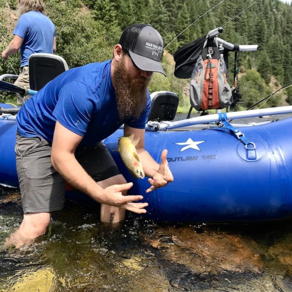 This photo shows Man Makes Fire expert fly fishing and rafting gear testers out on the river testing and fishing with the NRS Star Outlaw Raft Fishing Package.