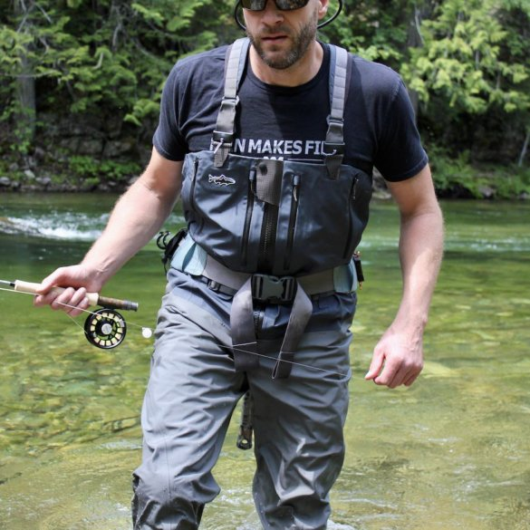 This photo shows the author testing the Patagonia Swiftcurrent Expedition Zip-Front Waders while fishing on a river.
