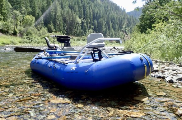 This photo shows the NRS STAR Outlaw 140 raft with an NRS fishing frame setup on a river.