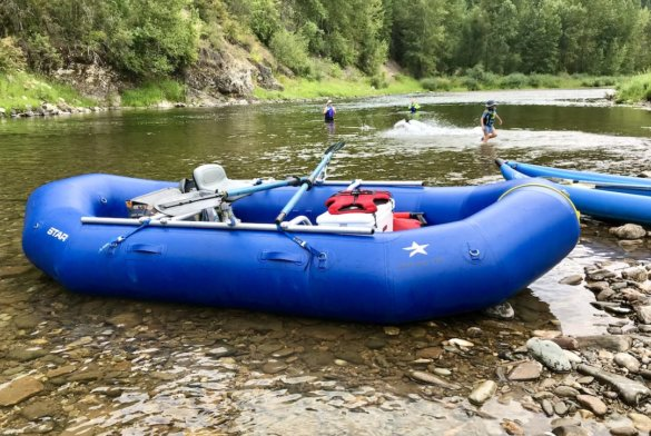 This photo shows the STAR Outlaw 140 raft being used for a float and swim trip on a river.