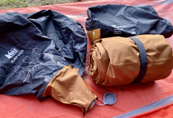This photo shows the stuff sack, pump sack and REI Camp Dreamer Insulated Air Sleeping Pad.