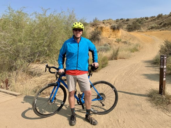 This photo shows the author wearing the Showers Pass Ultralight Wind Jacket out on a gravel bike ride.