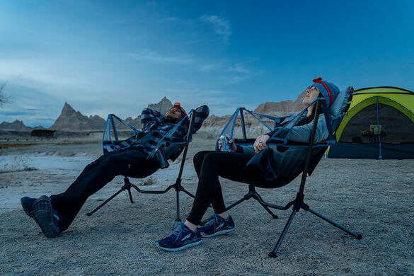 This photo shows the Nemo Stargaze Recliner Luxury Chair camping gift in use while out camping.