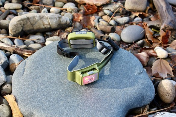 This photo shows the BioLite HeadLamp 750 outside with the red light on.