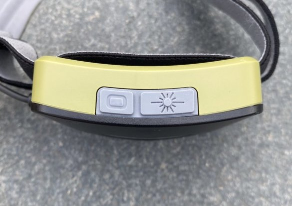 This photo shows the red light and burst mode buttons on the BioLite HeadLamp 750.